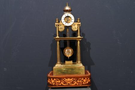 Orologio scheletrato in ottone