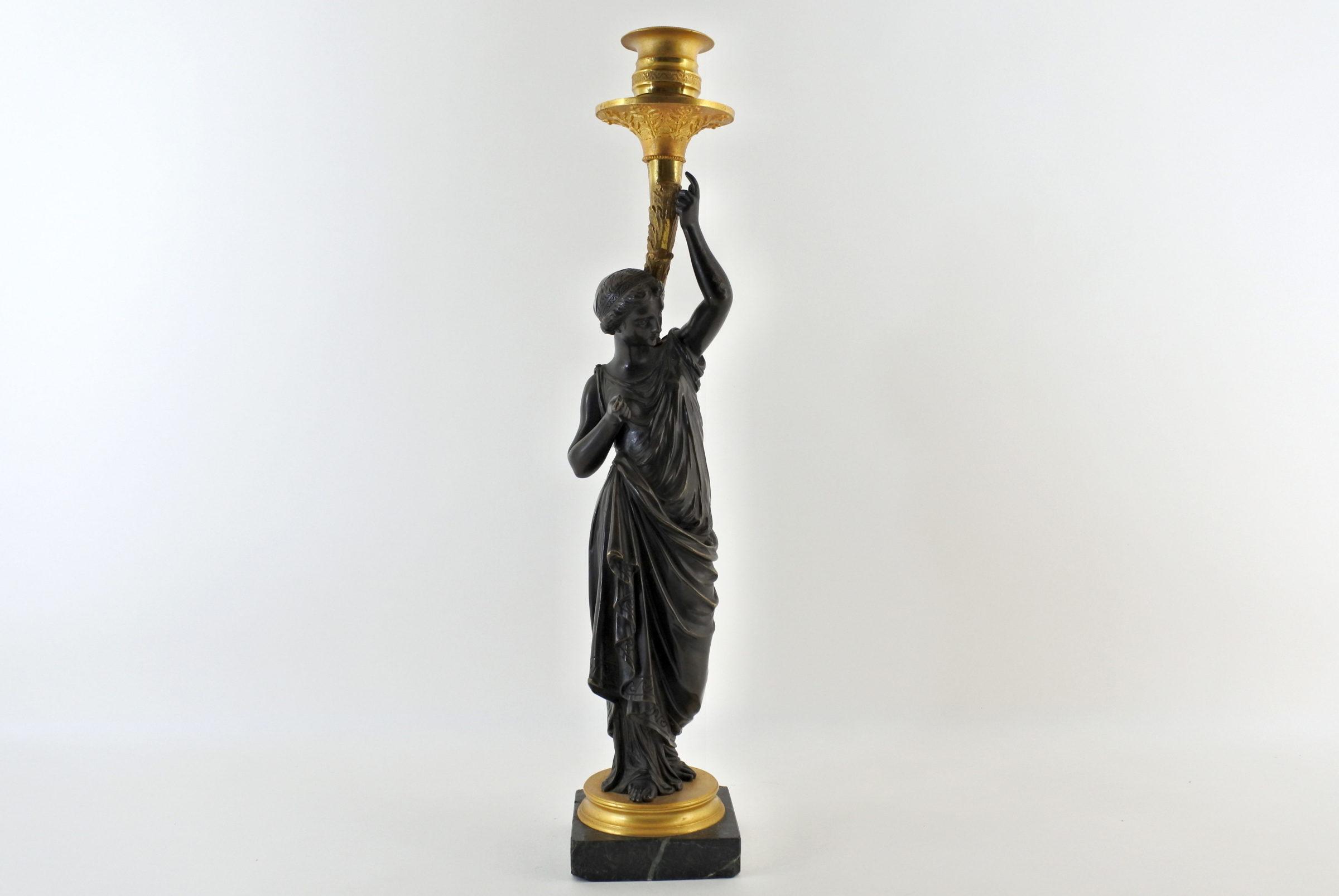 Candeliere in bronzo con parti dorate al mercurio