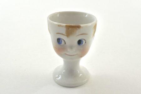 Portauovo in ceramica a forma di viso di bimbo