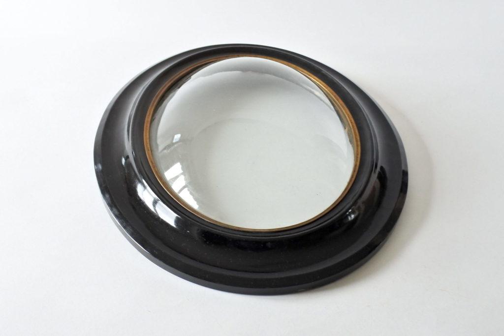 Cornice ovale in legno ebanizzato con vetro soffiato bombato