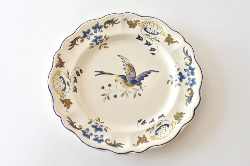 Piatto in ceramica di Longchamp con uccellino e ramo di fiori