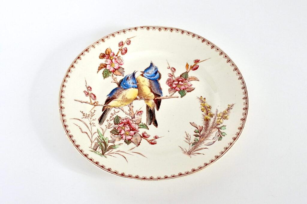 Piatto in ceramica di Luneville con coppia di uccellini su ramo fiorito
