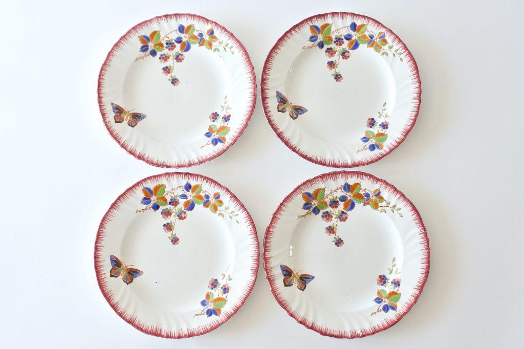 4 piatti da frutta in ceramica di Longwy con farfalla e frutti di rovo