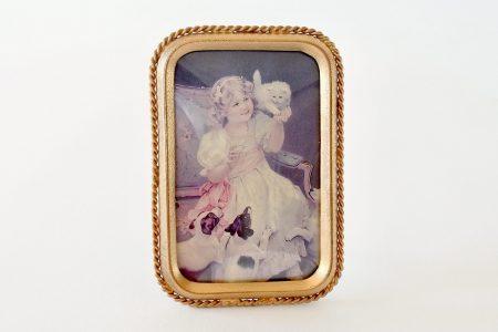 Cornice portafoto in lamierino di ottone dorato